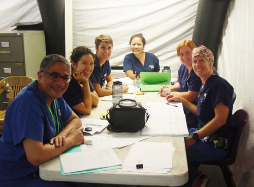Dr. Emil, Dr. Yasmine Yousef, and Africa Mercy nurses preparing OR schedule