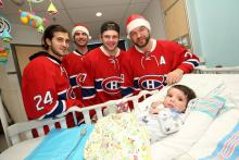 Little Adam with players from the Montreal Canadiens.