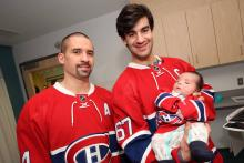 Little Connor with Max Pacioretty and Tomas Plekanec.