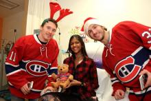 Allyssa smiles with Brendan Gallagher and Brian Flynn.
