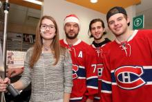 Félicia smiles with André Markov, Philip Danault and Alex Galchenyuk.