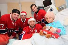 Kayla smiles with players from the Montreal Canadiens.