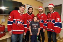 Gregory smiles with Alex Galchenyuk, Phillip Danault, Andre Markov and Al Montoya.