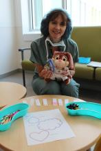 Exam station 2 is coordinated by Child Life Specialist, Nathalie, and is supplied with all kinds of scents to be placed inside teddy bear masks to help them relax before falling asleep for surgery.