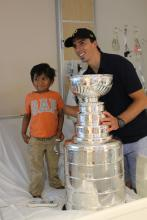 Aneesh with Marc-André Fleury and Lord Stanley's Cup.