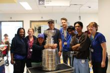 The B08 unit staff with Marc-André Fleury and Lord Stanley's Cup.